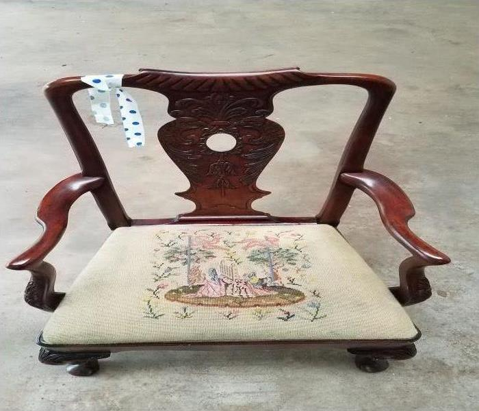 antique decorative arm chair with dirty seat