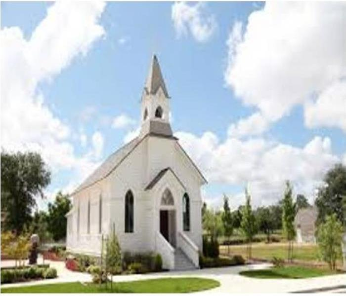 Traditional steeple church on beautiful garden grounds